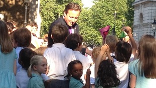 David Cameron shakes the hands of children in Downing Street