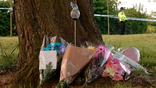 Flowers laid by members of the local community for Amber Peat