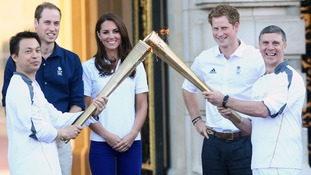Royals welcome Olympic Torch on penultimate day of UK tour
