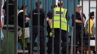 Border Force agents lead away some of those found inside the lorries