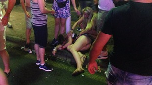 Holidaymakers in Magaluf help a drunken girl