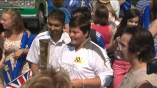 Harry Moseley's mum carries Olympic Torch