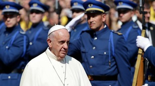 Pope Francis urged Bosnia's Muslim, Orthodox and Catholic communities to work together.