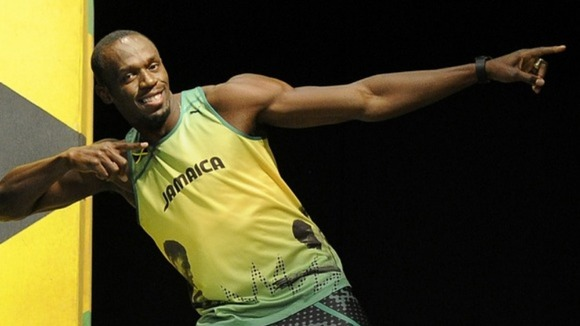 Usain Bolt models the Jamaican team's kit for London 2012