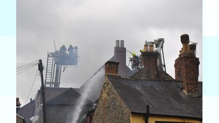 Firefighters dealing with the blaze.