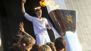 Torchbearer Tyler Rix lighting the cauldron with the Olympic Flame in Hyde Park.
