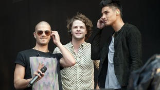 Max George, Jay Maguiness and Siva Kaneswaran of The Wanted on stage.