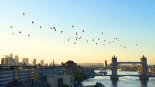 Hot air balloons over Tower Bridge