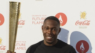 Dizzee Rascal holding an Olympic Torch backstage at the Coca Cola London 2012 Olympic Torch Relay concert, in Hyde Park.
