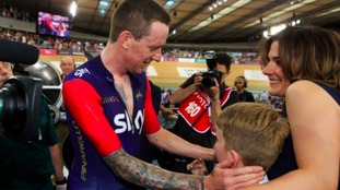 Sir Bradley Wiggins celebrates beating the record with his family.