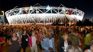 Crowds leave the dress rehearsal for Friday's opening ceremony.