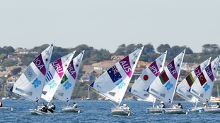 Laser Radial sailors practice on the waters of Portland Harbour in Dorset, the sailing venue of the London 2012 Olympics.