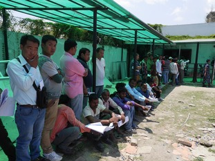 Migrant workers line up to get permits to travel.