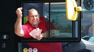 Sean Lloyd, Lottery winner, returned to work and helped out commuters.