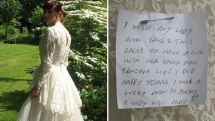 The charity shop is hoping to track down the man who left this dress and note.
