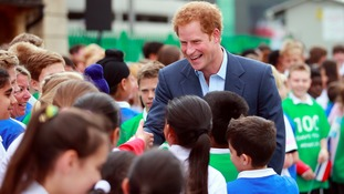 Prince Harry talks to school children at Twickenham as part of the 100 day Rugby World Cup Trophy Tour of the UK & Ireland.