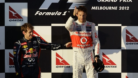 Button is congratulated by Red Bull's Vettel on the podium at the Albert Park circuit