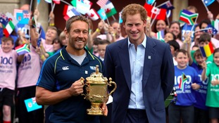 Prince Harry and Former England player Jonny Wilkinson with the Web Ellis Cup during the 100 days until the start of the 2015 Rugby World Cup event at Twickenham Stadium, London.
