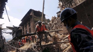 Rescue workers clear debris from a collapsed house in the ancient city of Bhaktapur