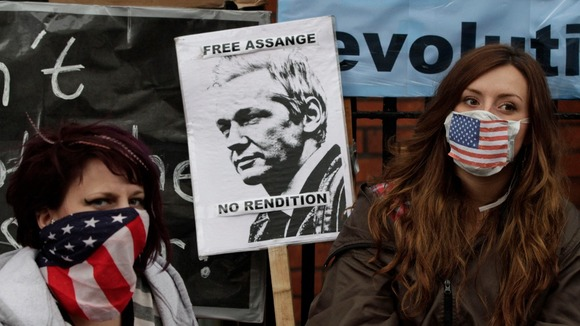 Protestors show support for Julian Assange outside the Ecuadorian embassy in London where he's sought asylum