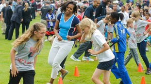 Michelle Obama joins in at the Let's Move event at the US Ambassadors residence in London.