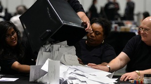 Votes are verified during the count at the Excel Centre in London, for a new mayor to replace ousted mayor of Tower Hamlets Lutfur Rahman