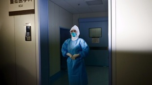 A medical worker in a protection suit at a hospital where a South Korean Mers patient is being quarantined.