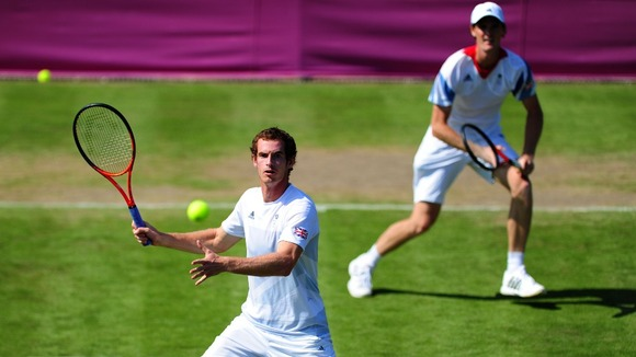 Andy and Jamie Murray practice at Wimbledon ahead of their first round doubles match.