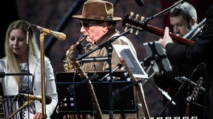 Van Morrison performing live on stage at the Hampton Court Palace Festival in London last summer.