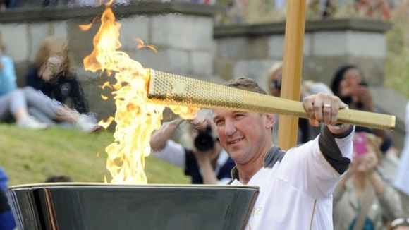 Matthew Pinsent lighting Olympic Cauldron