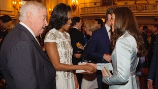 US First Lady Michelle Obama and US Ambassador Louis Susman (left) meet the Duchess of Cambridge