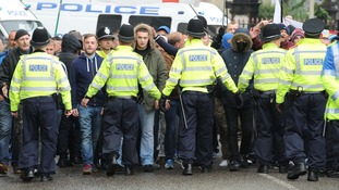 Around 100 people pressed against police lines