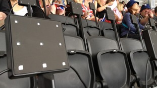 What appear to be light boxes built in to the seats at the Olympic Stadium