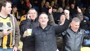Simon Dobbin (centre) at a Cambridge United match.