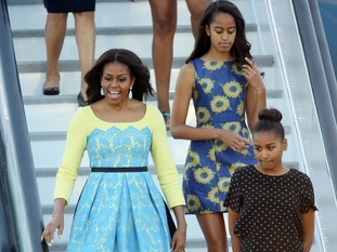 Mrs Obama travelled with her two daughters and her mother