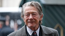 Sir John Hurt has been diagnosed with cancer but will keep working