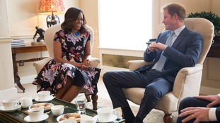 Michelle Obama (left) and Prince Harry