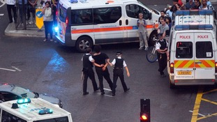 Police stop cyclists during 'critical mass' procession