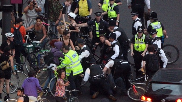 Police arrest protesters from the Critical Mass protest