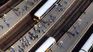A view of trains and passengers at London Bridge station in London from the 69th floor of the Shard.