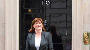 Nicky Morgan who remains Education Secretary arrives at 10 Downing Street in London, 2015.
