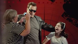 Schwarzenegger gives fans a fright posing as Terminator.