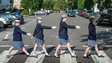 Pupils at The Kingsley School in Royal Leamington Spa recreate The Beatles record cover in a bid to find a crossing patrol person.