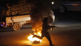 A armed anti-government protester in the suburbs of Damascus last night.