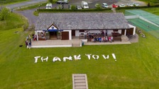 Junior club members spell out a message of thanks.