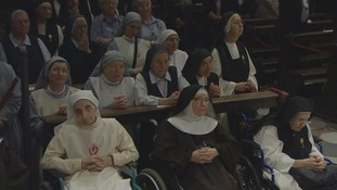 Nuns join the pope in prayer.