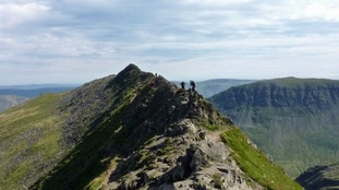 File photograph: Walkers make their way along Striding Edge.