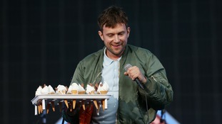 Damon Albarn hands out ice creams to the crowd at Blur homecoming gig