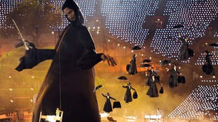 Mary Poppin's characters descend from the roof as a large puppet of Lord Voldemort is raised in the centre of the arena