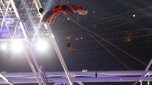 A parachutist doubling for the Queen at the Olympic Stadium